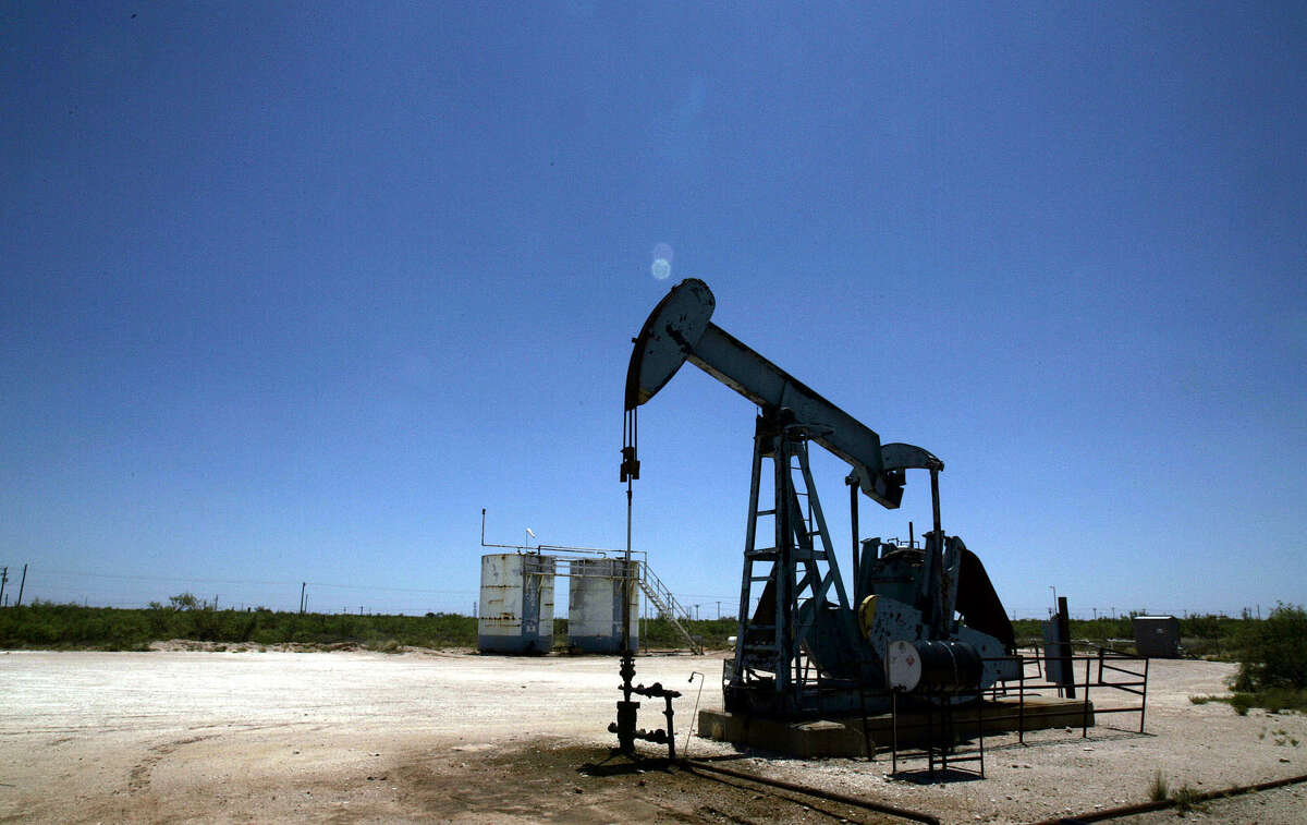 An oil pump works near Midland, Texas, Friday, July 14, 2006. The price of oil briefly surpassed $78 a barrel Friday and finished 4 percent higher for the week after Israeli attacks against Lebanese militants stoked fears of a wider Middle East conflict and possible oil-supply disruption. (AP Photo/LM Otero)