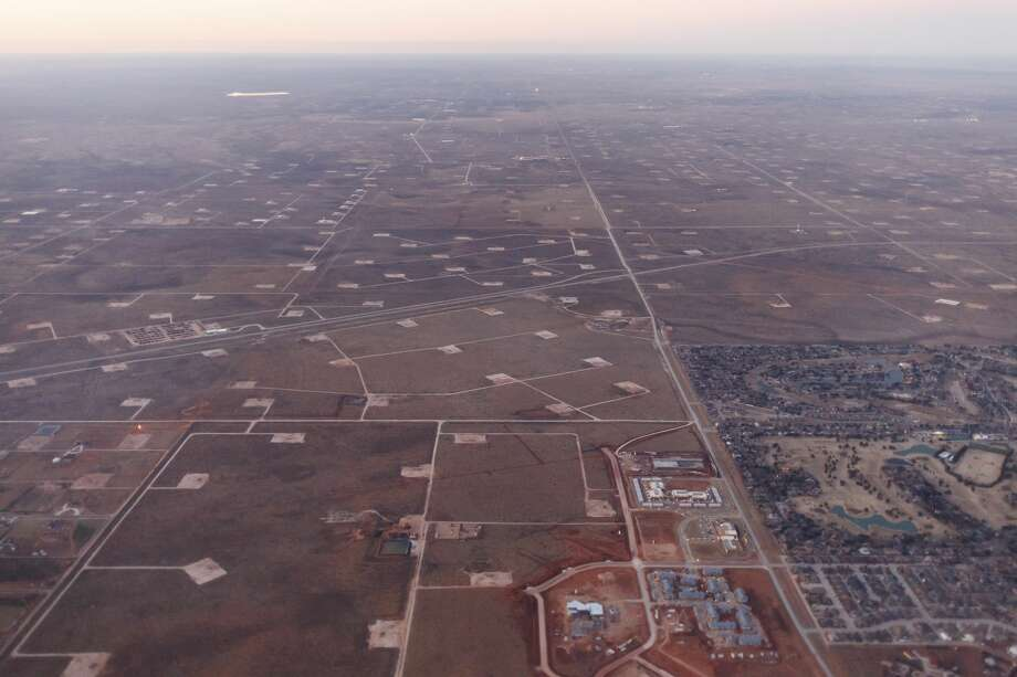 Oil well pads surrounding a development in Midland, Texas, Jan. 15, 2015. With oil prices plummeting by more than 50 percent since June, the gleeful mood of recent years has turned glum here in West Texas as the frenzy of shale oil drilling has come to a screeching halt. (Michael Stravato/The New York Times) Photo: MICHAEL STRAVATO/New York Times
