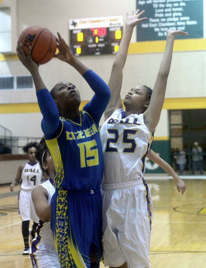 Ozen's Ashlei Kirven puts up a shot against the pressure of Galveston Ball's Chanielyn Galloway during Friday night's Class 5A playoffs game at East Chambers High School. Photo taken Friday, February 17, 2017 Kim Brent/The Enterprise Photo: Kim Brent