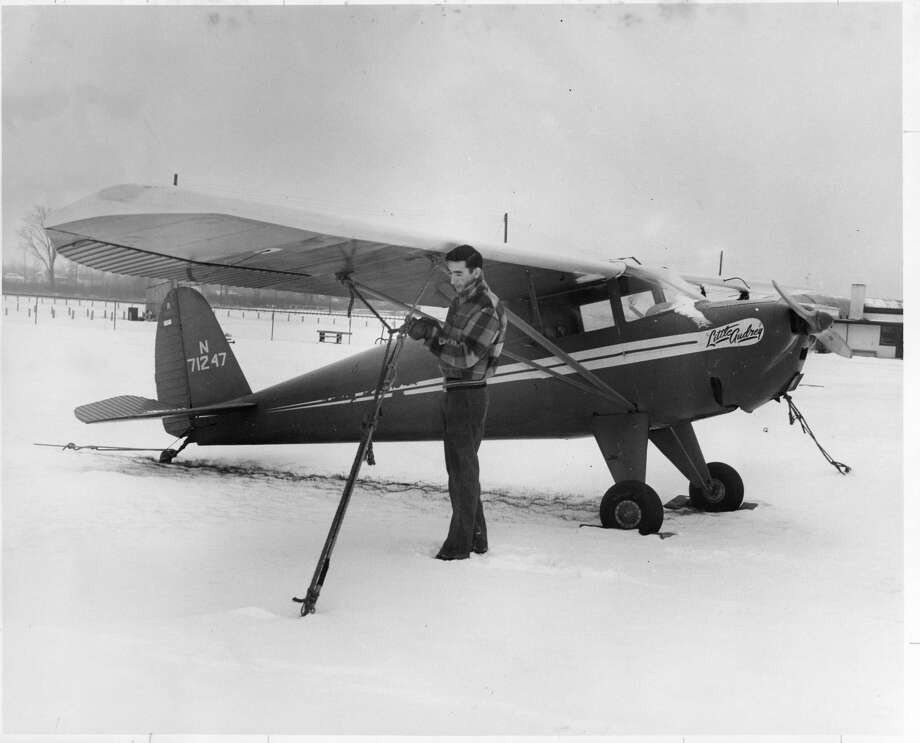 Edward A. Badour Jr., attendant at Midland's city-owned Jack Barstow Airport, is shown tying down one of the light craft — a one-engine two-seater plane. Badour is the airport's maintenance man, who keeps busy in the peak season refueling the planes and maintaining the runways, taxiways and grounds. January 1954 Photo: Daily News File Photo
