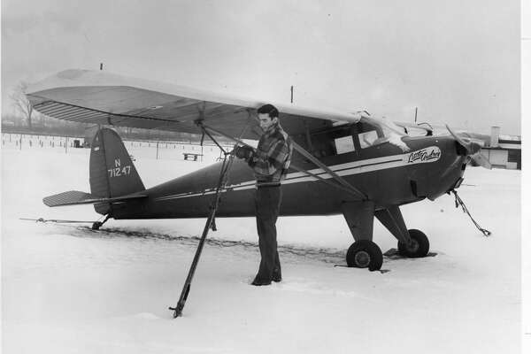 Edward A. Badour Jr., attendant at Midland's city-owned Jack Barstow Airport, is shown tying down one of the light craft - a one-engine two-seater plane. Badour is the airport's maintenance man, who keeps busy in the peak season refueling the planes and maintaining the runways, taxiways and grounds. January 1954