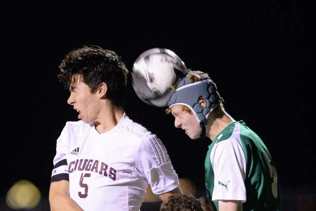 Nic Felden (5) of Cinco Ranch and Tom Haney (5) of Jesuit fight to head a ball during the first half of District 19-6A boys soccer game between the Cinco Ranch Cougars and the Strake Jesuit Crusaders on Friday February 17, 2017 at Cinco Ranch HS, Katy, TX.