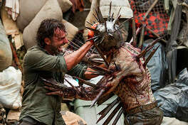 Andrew Lincoln as Rick Grimes, Gino Crognale as Walker - The Walking Dead _ Season 7, Episode 10 - Photo Credit: Gene Page/AMC