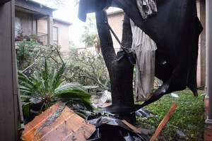 Damage assessment continues and cleanup beings Monday, Feb. 20, 2017, at ChateauxDijon condominiums in the 7700 block of Broadway, following a night of heavy thunderstorms across San Antonio.