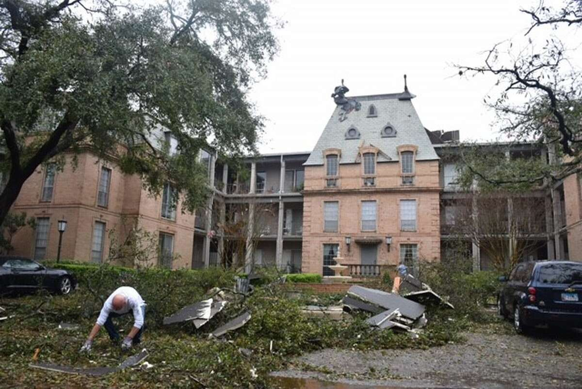 Cleanup began Monday, Feb. 20, 2017, at Chateaux Dijon condominiums in the 7700 block of Broadway, following a night of heavy thunderstorms across San Antonio.