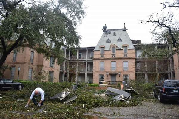 Damage assessment continues and cleanup beings Monday, Feb. 20, 2017, at Chateaux Dijon condominiums in the 7700 block of Broadway, following a night of heavy thunderstorms across San Antonio.
