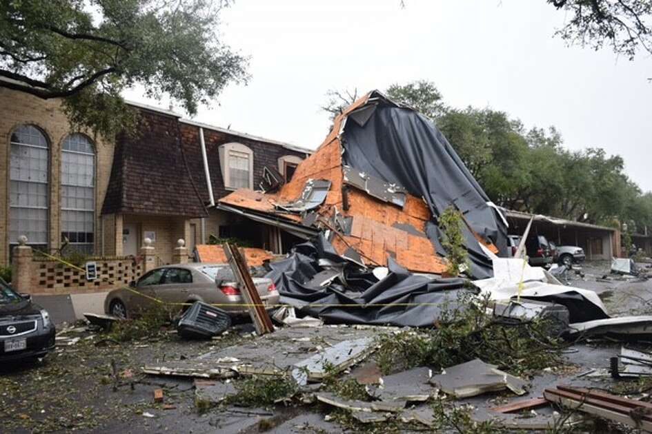 Damage assessment continues and cleanup beings Monday, Feb. 20, 2017, at Chateau Dijon condominiums in the 7700 block of Broadway, following a night of heavy thunderstorms across San Antonio.