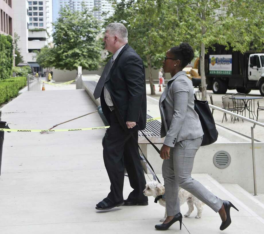 "Rear Admiral Robert J. Gilbeau enters the Federal Courthouse where he allegedly will plead guilty to lying to a federal investigator in the ""Fat Leonard"" navy bribery trial Thursday, June 9, 2016, in San Diego. (AP Photo/Lenny Ignelzi) Photo: Lenny Ignelzi, STF / Associated Press / Copyright 2016 The Associated Press. All rights reserved. This material may not be published, broadcast, rewritten or redistribu"