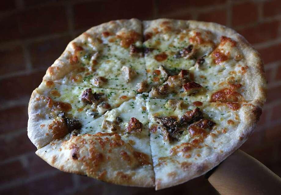 Mushroom pizza at Barbaro Photo: Bob Owen /San Antonio Express-News / © 2012 San Antonio Express-News