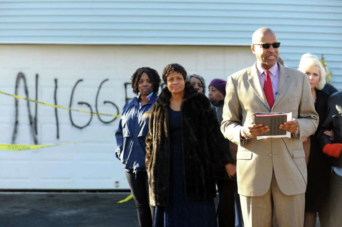 Jack Bryant, president of the NAACP's Stamford chapter, speaks during a press conference in front of the High Clear Dr. home where a racial slur was painted on the garage in Stamford, Conn. on Monday, Feb. 20, 2017. The incident happened in mid-January and the word still remains.