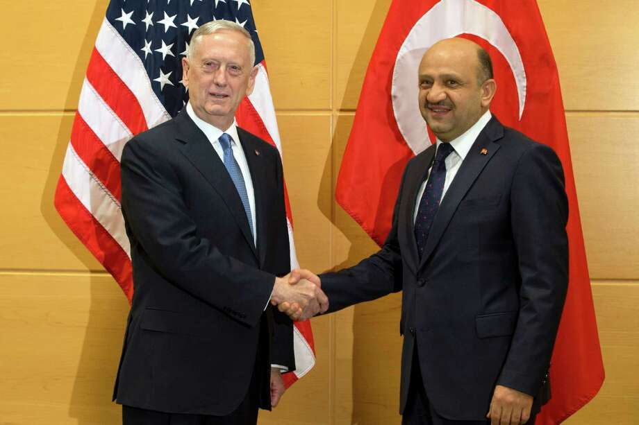 U.S. Secretary of Defense James Mattis (L) shakes hands with Turkish Defense Minister Fikri Isik during a meeting at NATO headquarters in Brussels on February 15, 2017.  NATO allies meet new US Defence Secretary James Mattis for the first time in Brussels seeking reassurance over President Donald Trump's commitment but bracing for military spending demands. / AFP PHOTO / POOL / Virginia MayoVIRGINIA MAYO/AFP/Getty Images Photo: VIRGINIA MAYO, Stringer / AFP/Getty Images / AFP