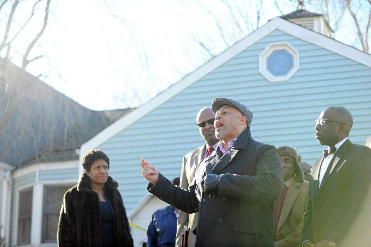 Guy Fortt speaks during a press conference in front of the High Clear Dr. home where a racial slur was painted on the garage in Stamford, Conn. on Monday, Feb. 20, 2017.