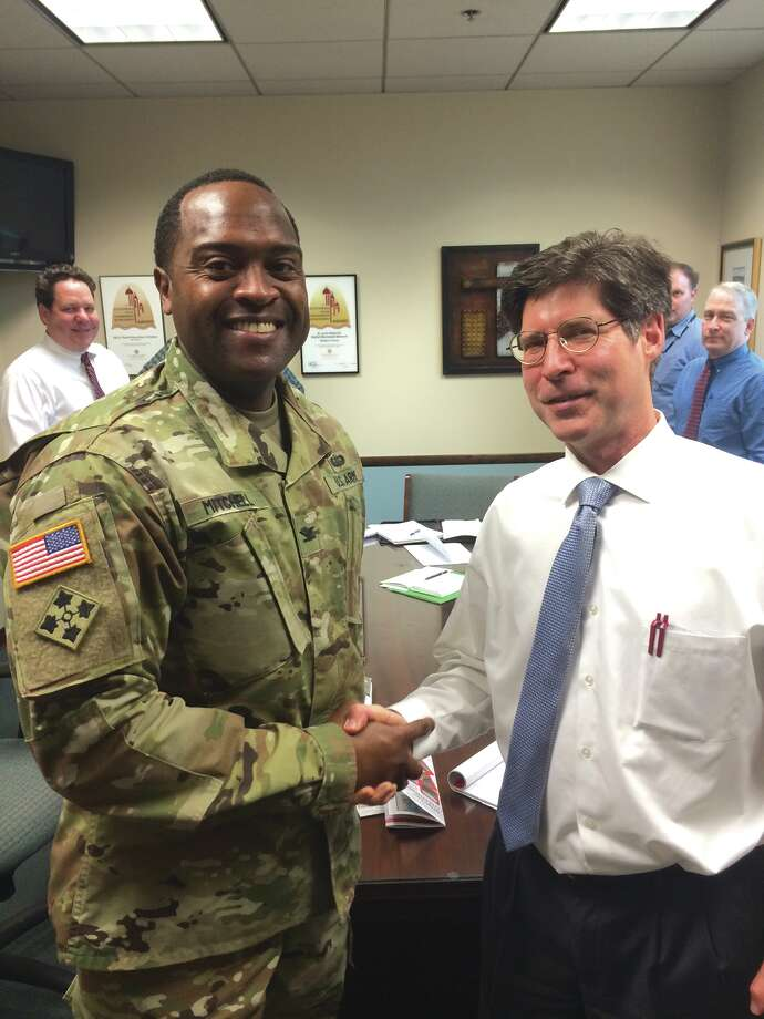U.S. Army Col. Anthony Mitchell meeets with Madison County Board Chairman Kurt Prenzler. Photo: For The Intelligencer