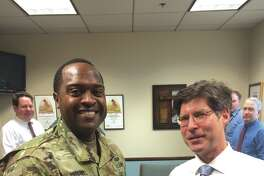 U.S. Army Col. Anthony Mitchell meeets with Madison County Board Chairman Kurt Prenzler.