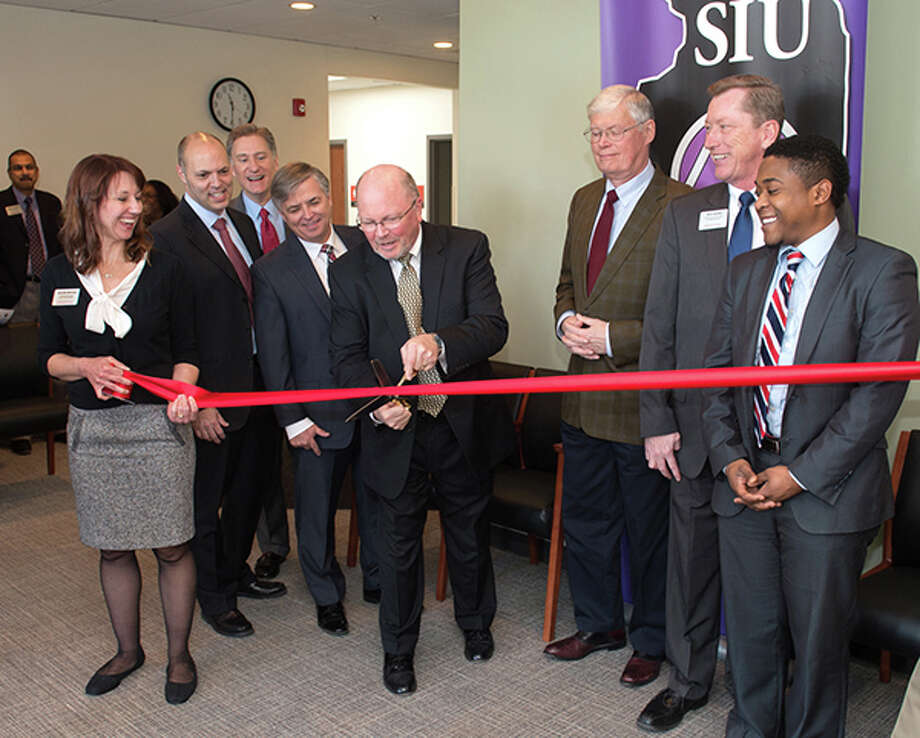 From left are Jennifer McClure, SIUE Marketing & Communications; Dr. Ken Rawson, SIU SDM associate dean; Dr. Randy Dunn, SIU system president; Dr. Randy Pembrook, SIUE chancellor; Dr. Bruce Rotter, SIU SDM dean; Illinois State Senator Bill Haine; Rich Walker, SIUE interim vice chancellor for administration; and Kevin Brooks, representing U.S. Senator Tammy Duckworth. Photo: For The Intelligencer