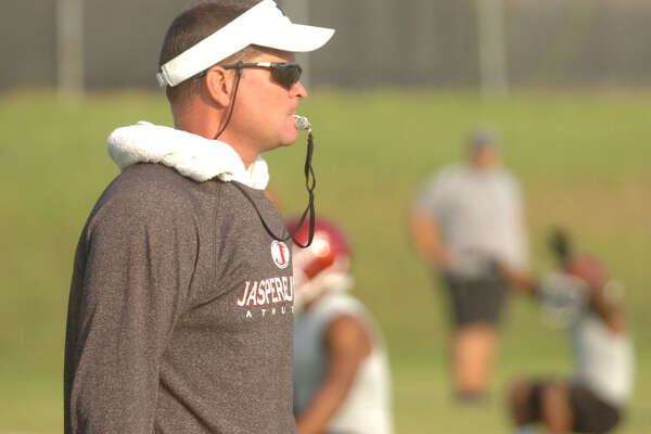 Jasper football coach Darrell Barbay instructs players during practice on Monday, Aug. 6, 2012.