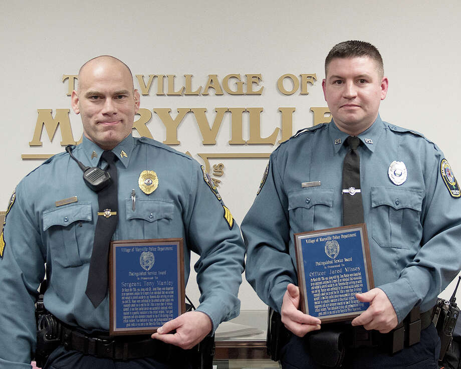 "Maryville Police Sgt. Tony Manley, left, and officer Jared Missey were given Distinguished Service Awards for their action during an incident involving a man who was trying to commit ""suicide by cop."" Photo: For The Intelligencer"