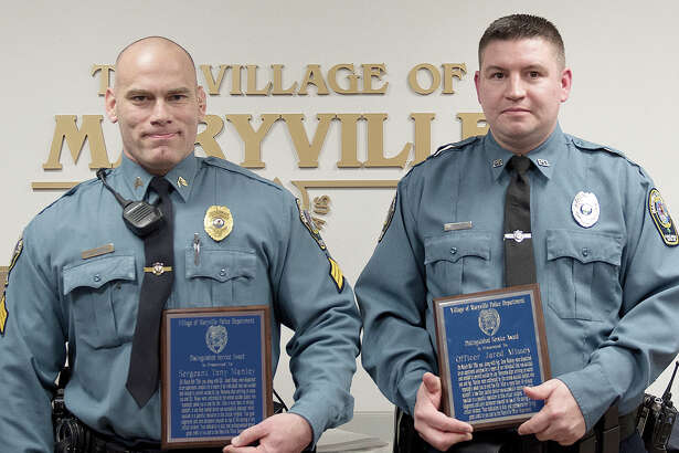"""Maryville Police Sgt. Tony Manley, left, and officer Jared Missey were given Distinguished Service Awards for their action during an incident involving a man who was trying to commit """"suicide by cop."""""""