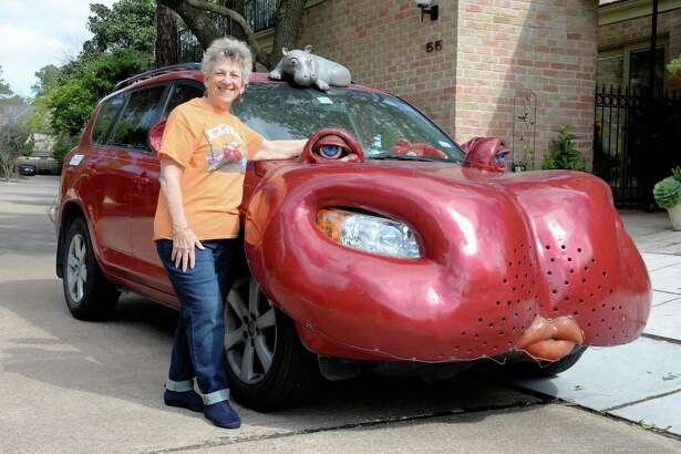 Sue Shefman shows-off her hippopotamus car on National Hippo Day, Houston, Texas on Wednesday, February 15, 2017.  The car is also depicted on the shirt she is wearing.
