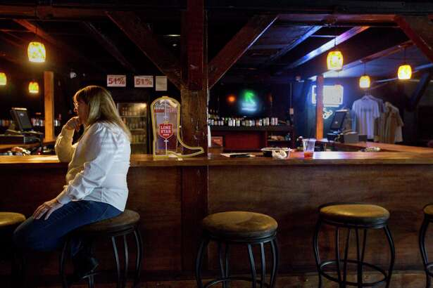 Sara Fitzgerald, who has owned the music venue Fitzgerald's for 40 years, sits at the downstair bar in the venue Wednesday, Feb. 15, 2017, in Houston.