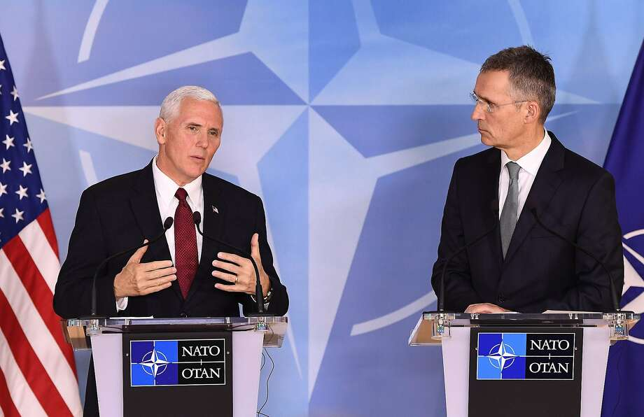 Vice President Mike Pence (left) and NATO Secretary General Jens Stoltenberg discuss global relations after a meeting at NATO headquarters in Brussels. Photo: EMMANUEL DUNAND, AFP/Getty Images