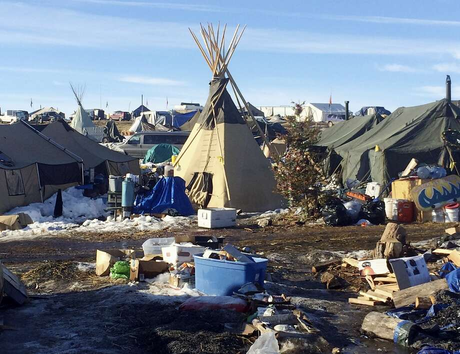 Debris awaits pickup by cleanup crews last week at the Dakota Access oil pipeline protest camp near Cannon Ball, N.D. Occupants of the camp have been told to vacate by Wednesday. Photo: Blake Nicholson, Associated Press