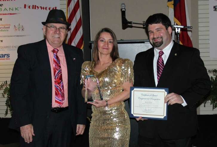 "Donna Kelso (middle) won the 2016 ""Jean McAdams"" Volunteer of the Year award, presented by Chamber COO Jim Carson (left) along with a certificate from Congressman Brian Babin's office, William Carter (right)."