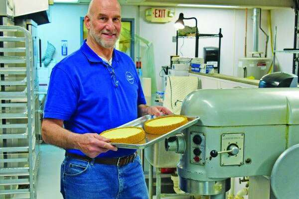 Tom Ginis, a mortgage loan officer at Residential Home Funding Corp., and his family run Poppy's Cheesecake, based in Bridgeport.