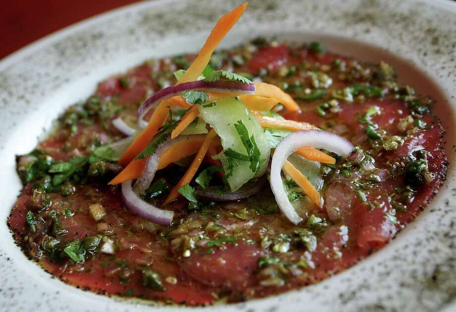Tuna carpaccio Photo: Bob Owen /San Antonio Express-News / © 2012 San Antonio Express-News