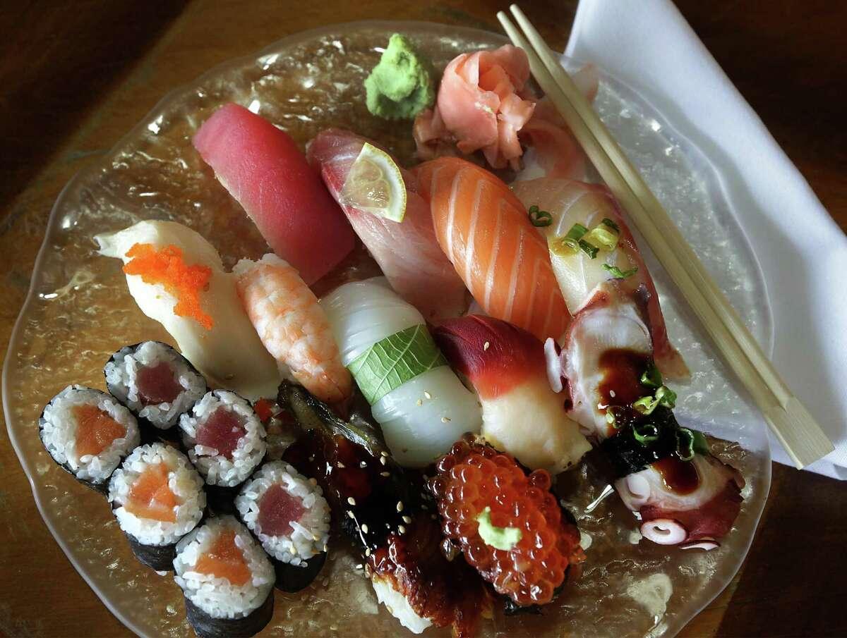 Goro's Combo includes tuna, hamachi, salmon, tai, escolar, shrimp, ika, clam, tako, unagi, salmon roe, half salmon roll and half tuna roll.