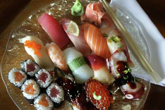 Goro's Combo includes tuna, hamachi, salmon, tai, escolar, shrimp, ika, clam, tako, unagi, salmon roe, half salmon roll and half tuna roll.