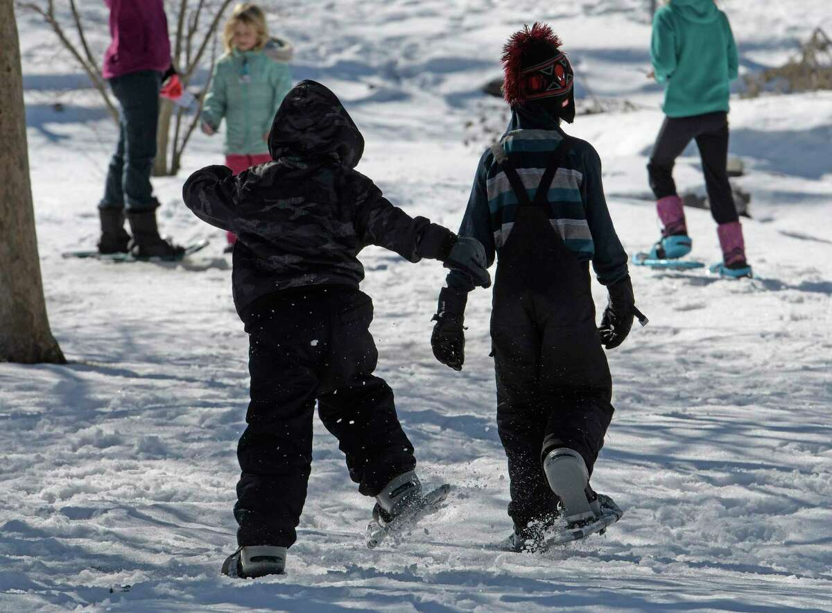 Snowshoeing is a great winter activity to get kid out of the house. (Skip Dickstein/Times Union)