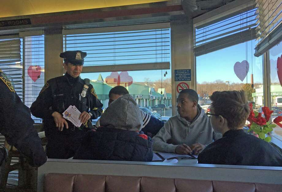 Norwalk police visited with some High Roads School students at the Family Diner as part of the department's Coffee with a Cop program. Photo: Leslie Lake / Hearst Connecticut Media / Norwalk Hour