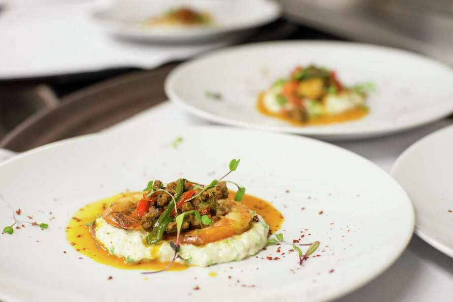 Shrimp and grits at Omni La Mansión del Rio feature Gulf shrimp with housemade chorizo, roasted peppers and smoked tomatoes. Photo: Courtesy Omni La Mansión Del Rio / Copyright © 2014 David Rangel