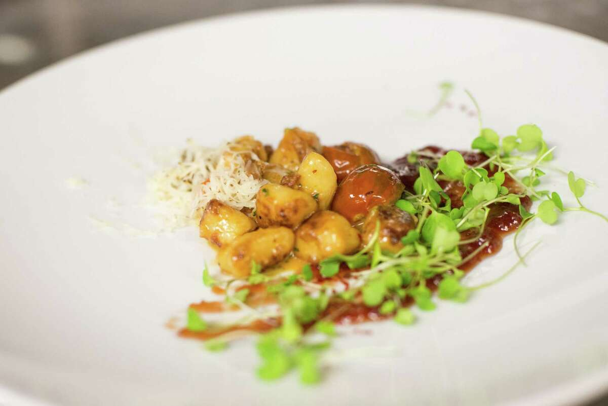 Parmesan gnocchi with Tuscan kale, pine nuts, butternut squash and golden raisins
