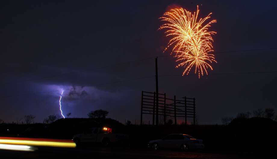 The WBCA H-E-B Fireworks Extravaganza lights up the sky along with a lightning strike on Sunday, Feb. 18, 2017 as this year's WBCA events come to a conclusion.