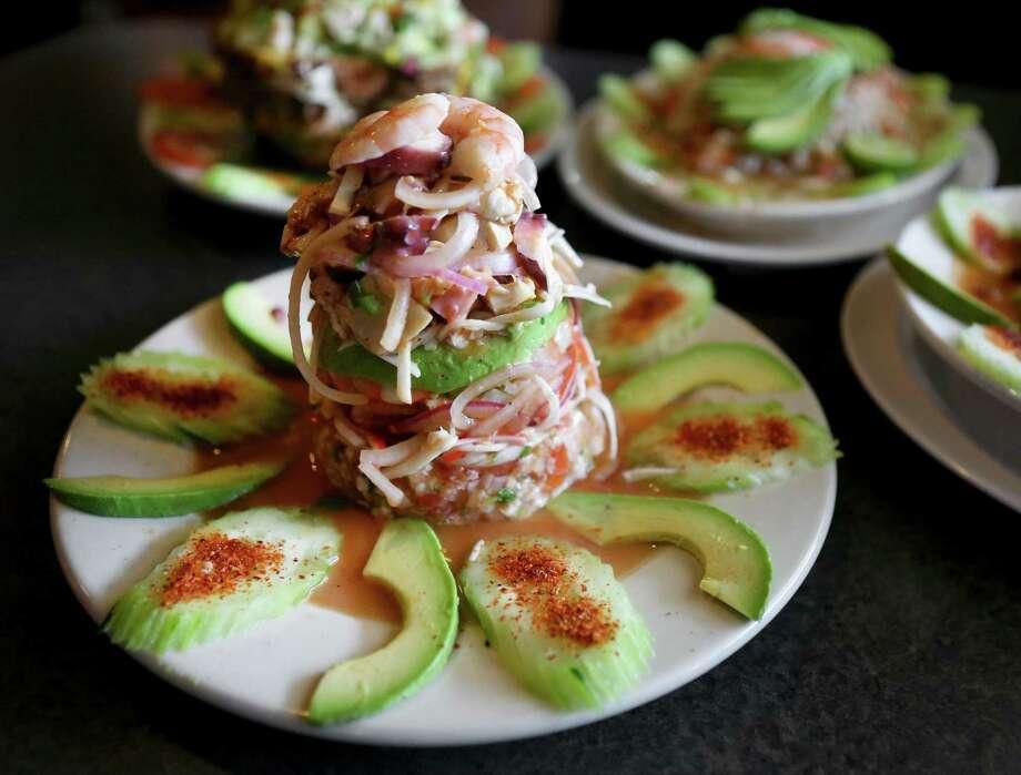 The Torre de Mariscos, prepared with shrimp, fish and octopus at Mariscos El Bucanero in San Antonio. Photo: Express-News File Photo / © 2014 San Antonio Express-News