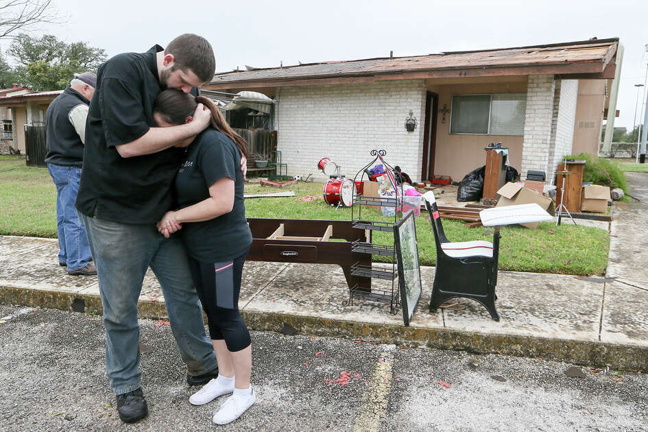 Clay Greenwell comforts Natalya Padilla outside her mother's damaged apartment unit at the High Key Apartments, 13012 Oak Terrace Dr, in Live Oak on Monday, Feb. 20, 2017.  A possible tornado overnight damaged five units in the complex as well as neighbood fences to the south and a Dairy Queen across the street at 8099 Village Oak.   MARVIN PFEIFFER/ mpfeiffer@express-news.net