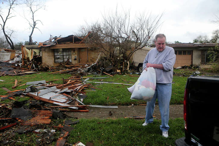 Greg Goza leaves his mother-in-law's home Monday February 20, 2017 at 455 Linda after a tornado swept through the area last night. Goza was leaving the house after noticing an odor of natural gas.