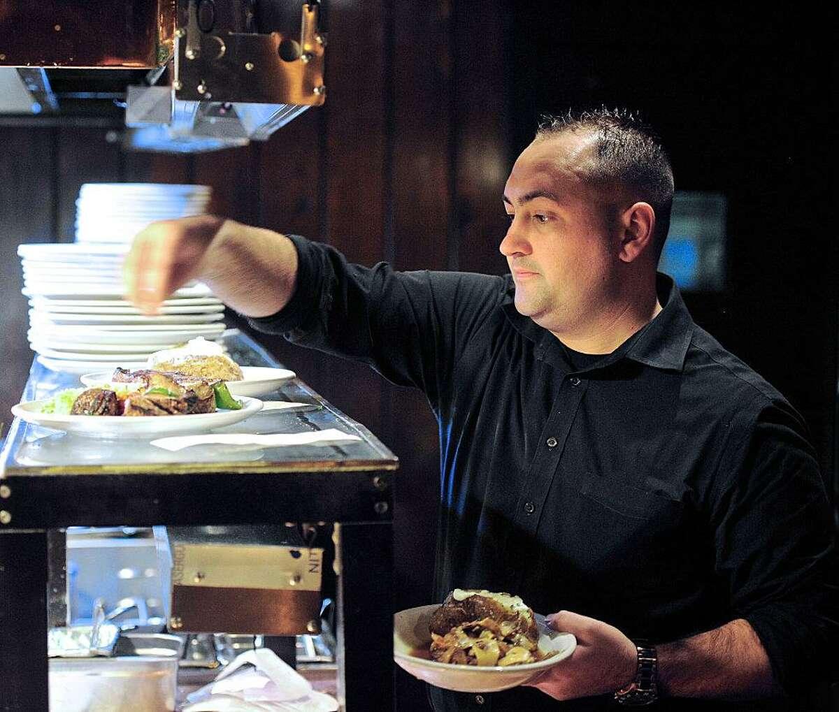 Waiter Douglas Makin picks up orders at Chuck's Steakhouse during Restaurant Week in Danbury in 2016.