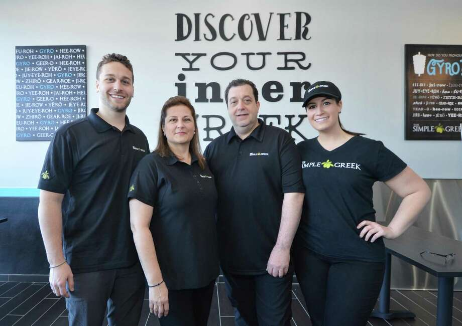 The Pertesis family George, Maria, John and Christina at The Simple Greek at 440 Westport Ave. in Norwalk, Conn., slated to open Tuesday, Feb. 21, 2017 as the franchisor's first Connecticut location. Photo: Alex Von Kleydorff / Hearst Connecticut Media / Connecticut Post