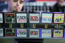 A bartender serves one of Lagunitas' 20 beers on tap in Ballard on Saturday, Feb. 18, 2017.