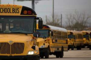 A Houston ISD bus driver leaves the HISD Northwest Shop on the 6300 block of Pinemont Drive as he headed out on a afternoon route Thursday, Jan. 8, 2015, in Houston. Hundreds of Houston ISD students had their school bus service interrupted Thursday morning after numerous bus drivers refused to drive their routes over a pay dispute.