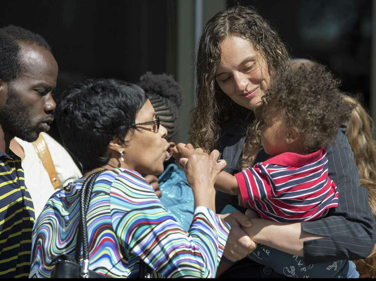 Kalion Busby, from left, Constontial Busby, Alessandra Busby, and 14-month-old Riplion Busby leave the courthouse after the punishment phase of the trial of Qwalion Busby and Marquita Johnson, who were convicted of injury to a child by omission in regard to the death of their infant son in 2015, Thursday, Feb. 16, 2017, in the 290th District Court in San Antonio. (Darren Abate/For the San Antonio Express-News)