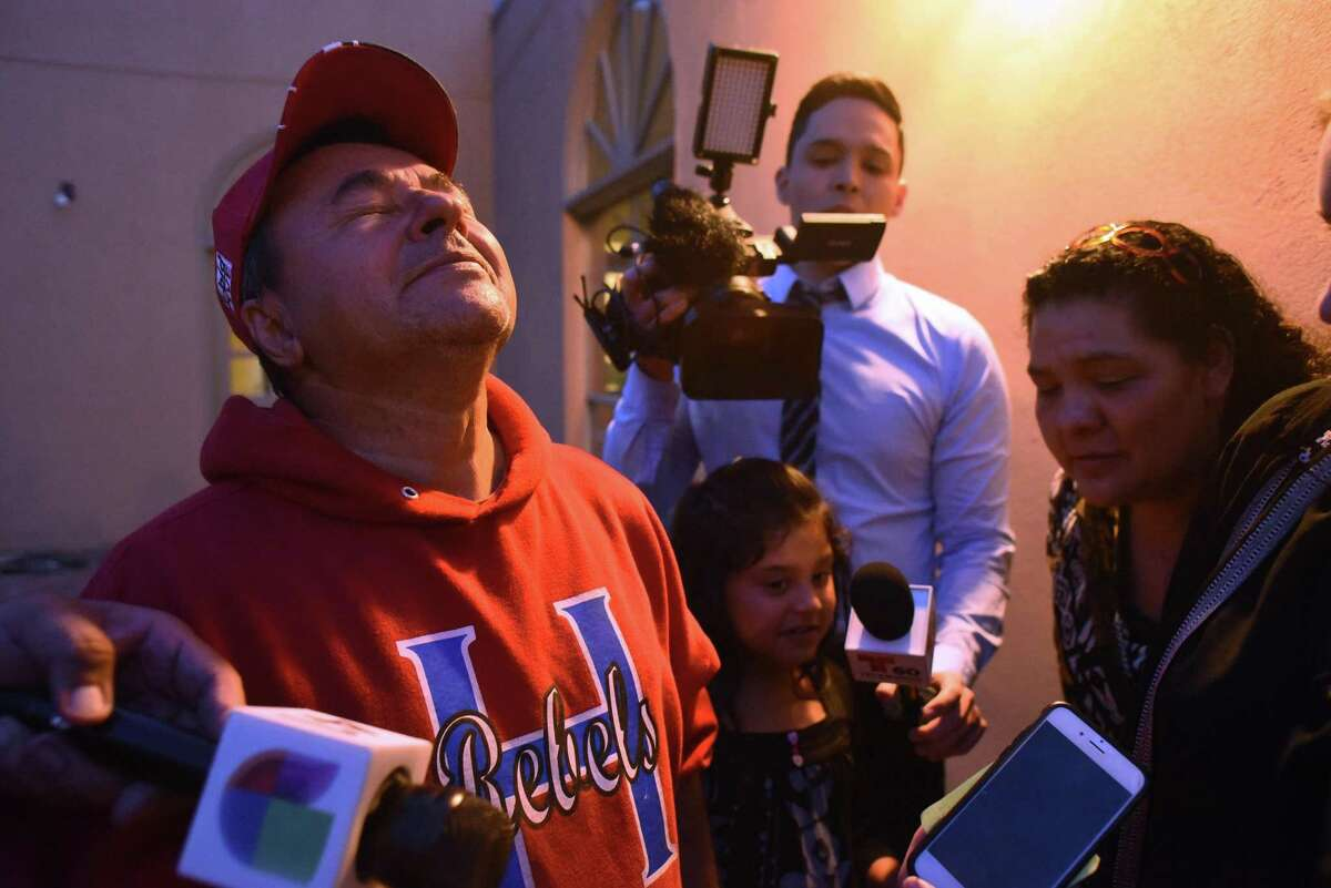 Jose Romero, father of Josue Romero, 18, a Honduran who was brought to this country as a child and was under DACA protection until he was arrested on Wednesday night and transferred to ICE and now faces deportation, reacts with relief as he learns that his son has been released from custody. Feb. 16, 2017.