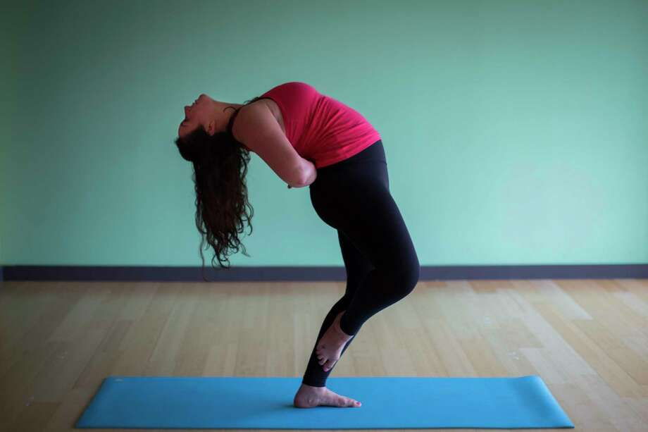 Today's #ChronFit Challenge pose of the day is Standing Backbend, demonstrated by Brit Gomez, an instructor at BIG Power Yoga. ( Marie D. De Jesus / Houston Chronicle ) Photo: Marie D. De Jesus, Houston Chronicle / © 2017 Houston Chronicle