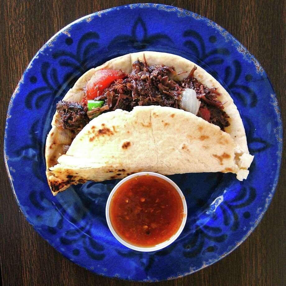 Barbacoa a la mexicana taco on a flour tortilla from La Amistad Tortilleria. Photo: Mike Sutter /San Antonio Express-News