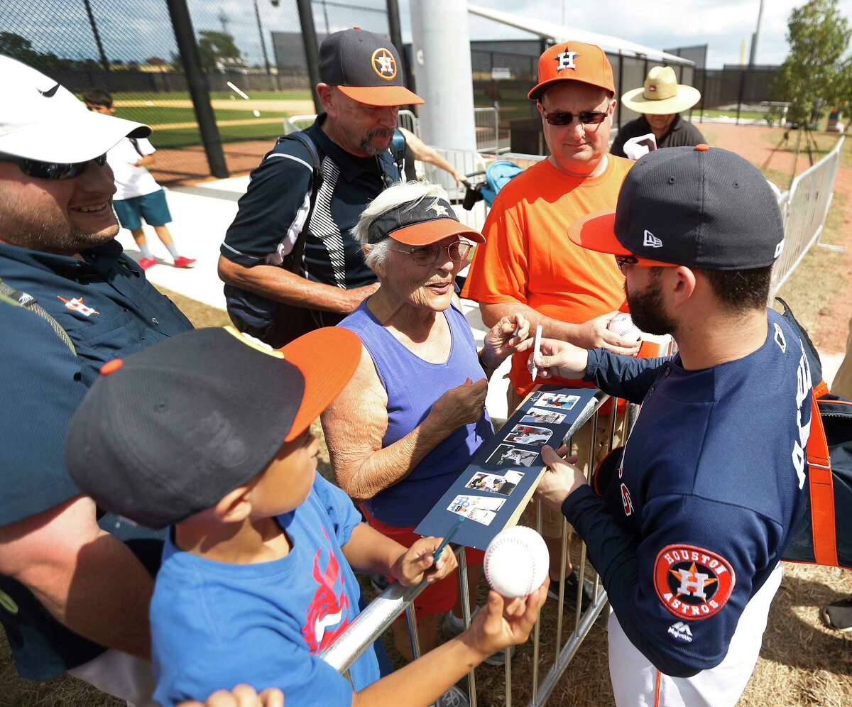 Houston Astros second baseman Jose Altuve (27) signs an autograph for Jan Mingus, of Houston, during spring training at The Ballpark of the Palm Beaches, in West Palm Beach, Florida, Monday, February 20, 2017.
