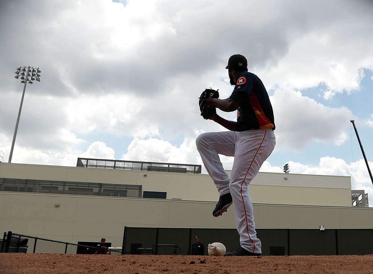 Houston Astros pitcher Reymin Guduan (64) warms up on the ten-pack before throwing live batting practice during spring training at The Ballpark of the Palm Beaches, in West Palm Beach, Florida, Monday, February 20, 2017.