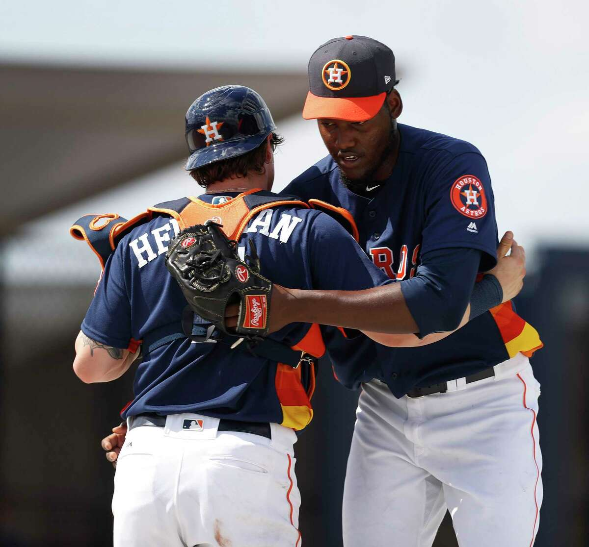 Houston Astros catcher Tyler Heineman (71) hugs pitcher David Paulino (63) after Paulino threw a live batting practice during spring training at The Ballpark of the Palm Beaches, in West Palm Beach, Florida, Monday, February 20, 2017.